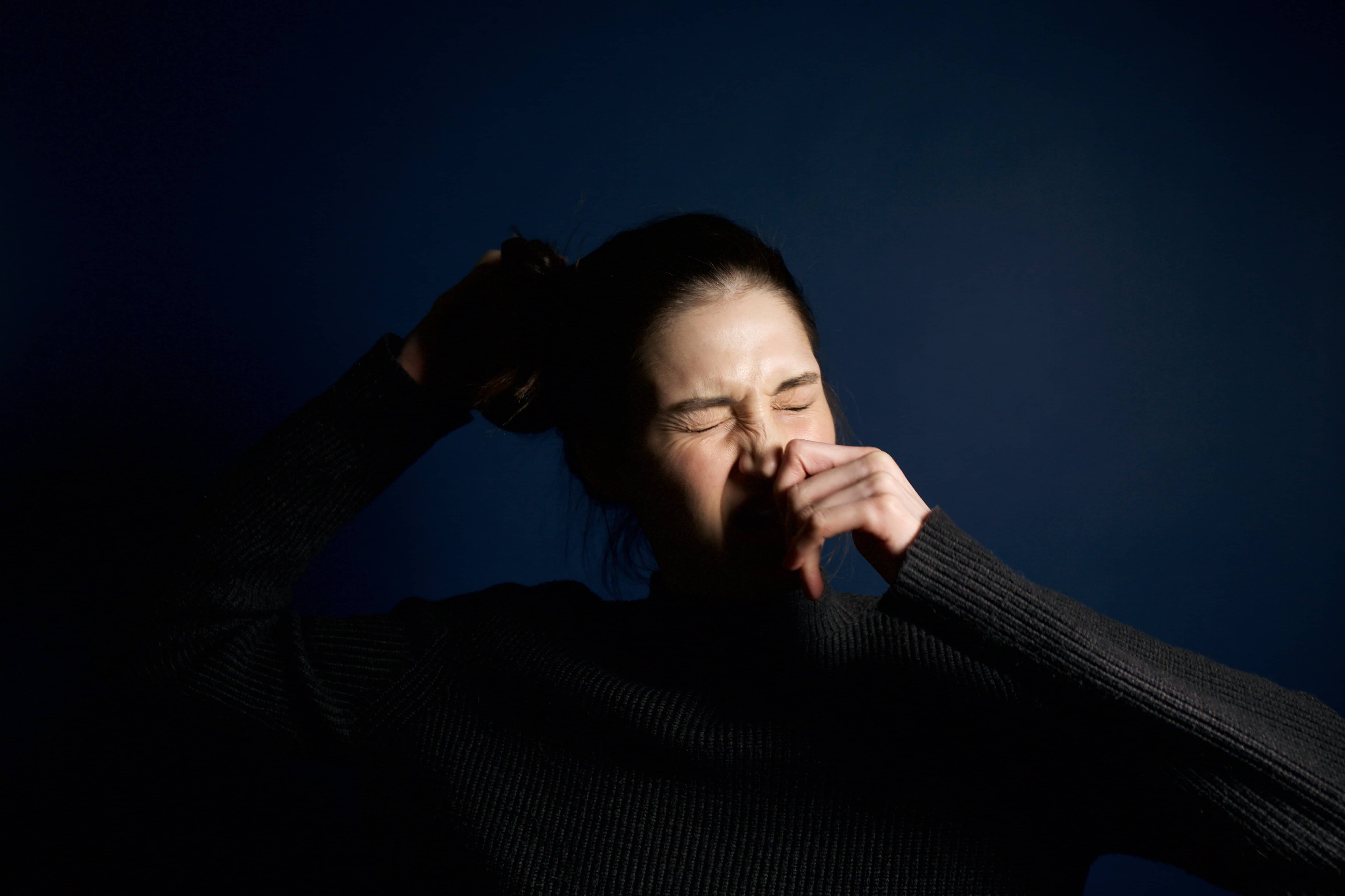 woman sneezing from allergies
