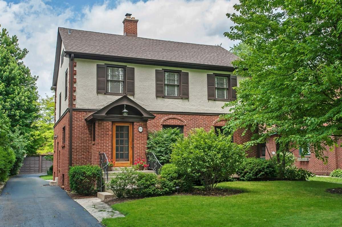 Brick home with green grass