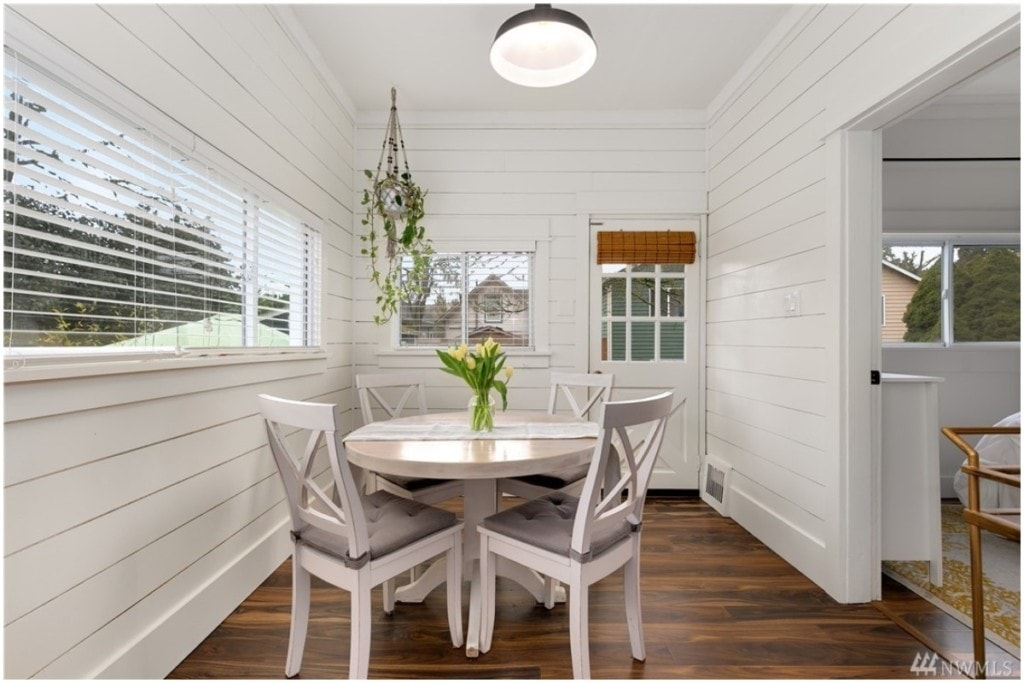 white dining area with round table