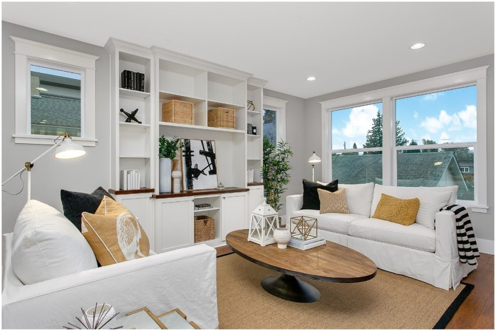 living room with two couches and windows