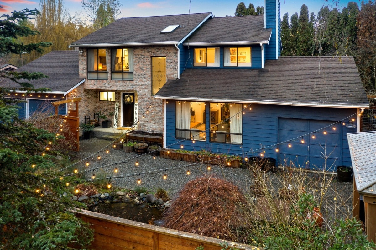 blue-and-stone-home-with-lights